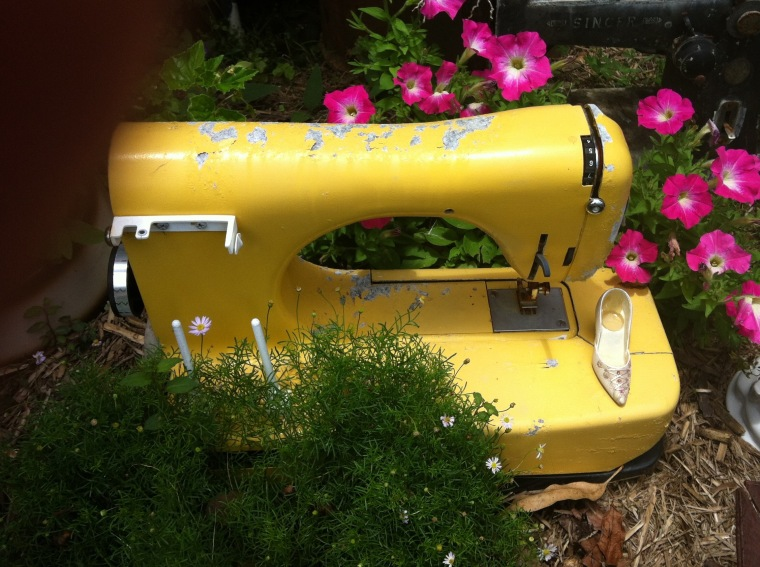 Old yellow sewing machine in a garden